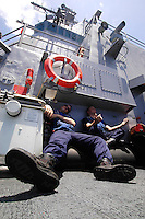 060413-N-7981E-105 Pacific Ocean (April 13, 2006)- Seaman Hill and SHSN West cool off in the shade aboard the Arleigh Burke-class guided missile destroyer USS Shoup (DDG-86) after taking part in an underway replenishment between Shoup and the combat stores ship USNS San Jose (T-AFS-7). Shoup is currently underway in the Western Pacific operating area. U.S. Navy photo by Photographer's Mate Airman James R. Evans (RELEASED)