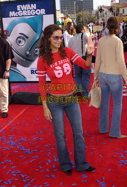 "HALLE BERRY.The Twentieth Century Fox's Los Angeles Premiere of ""Robots"" held at The Mann Village Theatre in Westwood, California .March 6th, 2005.full length sunglasses shades von dutch red top jeans denim waving gesture.www.capitalpictures.com.sales@capitalpictures.com.Supplied By Capital PIctures"