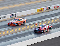Sep 16, 2016; Concord, NC, USA; NHRA pro mod driver Robert Patrick (right) races alongside Jonathan Gray during qualifying for the Carolina Nationals at zMax Dragway. Mandatory Credit: Mark J. Rebilas-USA TODAY Sports