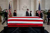People walk past the late Supreme Court Justice John Paul Stevens as he lies in repose in the Great Hall of the Supreme Court in Washington, Monday, July 22, 2019.<br /> Credit: Andrew Harnik / Pool via CNP