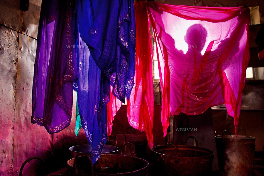 Azerbaijan, Sheki (Shaki), Silk Factory, April 18, 2012<br /> A worker in the silk factory hangs newly dyed silk cloths to dry. All of the dyes are made from natural sources, mostly plants. Sheki has been famous for its silk since ancient times. During Soviet rule, Sheki was the center of the silk industry and home to the Soviet Union&rsquo;s largest silk plant.<br /> <br /> Azerba&iuml;djan, Cheki (Shaki), une fabrique de soie, 18 avril 2012.<br /> Une employ&eacute;e de la fabrique de soie &eacute;tend des draps de soie tout juste teints afin qu&rsquo;ils s&egrave;chent. Tous les colorants sont fabriqu&eacute;s &agrave; partir d&rsquo;&eacute;l&eacute;ments naturels, pour la plupart des plantes. Cheki est c&eacute;l&egrave;bre pour sa soie depuis les temps anciens. Sous l'&egrave;re sovi&eacute;tique, Cheki &eacute;tait le centre de l'industire de la soie. Ses cultures &eacute;taient les plus importantes dans toute l'Union Sovi&eacute;tique.