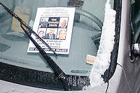 """A leaflet with pictures of the Bushes and Clintons reading """"The Dynasty Bunch"""" and """"Say no to Jeb! and Hillary"""" lays under the windshield wiper of a car while  while Republican presidential candidate and former Florida governor Jeb Bush speaks at a town hall in Souhegan High School in Amherst, New Hampshire. Campaign staff removed the flyers from cars."""