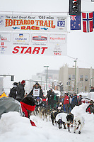 Gerry Willomitzer leaves the 2011 Iditarod ceremonial start line in downtown Anchorage, during the 2012 Iditarod..Jim R. Kohl/Iditarodphotos.com