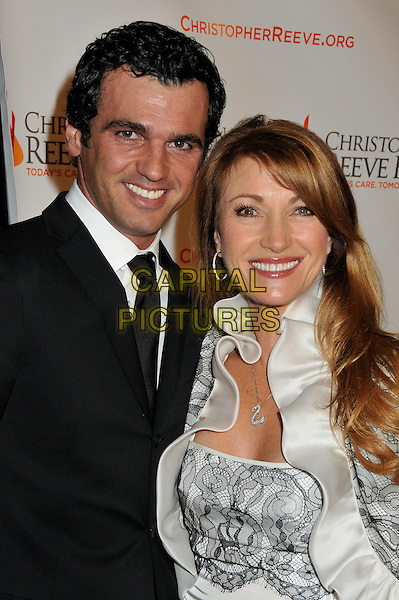 TONY DOVOLANI & JANE SEYMOUR.4th Annual Christopher & Dana Reeve Foundation Benefit Gala at the Beverly Hilton Hotel, Beverly Hills, California, USA..December 2nd, 2008.half length suit jacket white black grey gray lace jacket silk satin ruffled ruffles dress Dancing With The Stars.CAP/ADM/BP.©Byron Purvis/AdMedia/Capital Pictures.