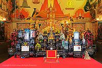 """Bot and gilded altar of """"Luang Pho To"""" Wat Intharawihan, Bangkok, Thailand."""