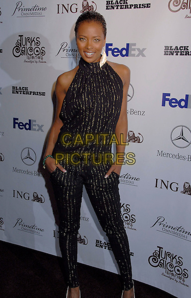 EVA PIGFORD.Black Enterprise Top 50 Hollywood Power Brokers List Party held at the Beverly Wilshire Four Seasons, Beverly Hills, California, USA, 21 February 2007..full length black and gold catsuit cat suit halterneck top matching trousers.CAP/ADM/GB.©Gary Boas/AdMedia/Capital Pictures.