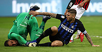 Calcio, Serie A: Inter Milano - AC Milan , Giuseppe Meazza stadium, .October 21, 2018.<br /> Inter's captain Mauro Icardi (r) in action with Milan's goalkeeper Gianluigi Donnarumma (l) during the Italian Serie A football match between Inter and Milan at Giuseppe Meazza (San Siro) stadium, October 21, 2018.<br /> UPDATE IMAGES PRESS/Isabella Bonotto