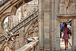 Tourists walk on the Duomo (Cathedral) rooftop