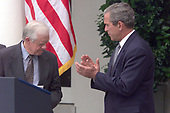 United States President George W. Bush accepts the report on election reform from former US President Jimmy Carter and former US  Representative Bob Michel (Republican of Illinois), who represented former US President Gerald R. Ford, in a Rose Garden ceremony at the White House in Washington, DC on July 31, 2001.<br /> Credit: Ron Sachs / CNP