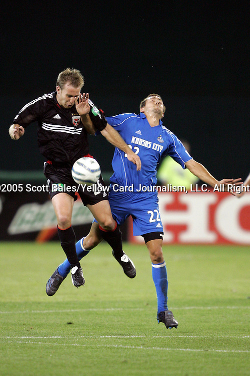 21 May 2005: DC United's Bryan Namoff (left) and Kansas City's Davy Arnaud battle for a ball in midfield. DC United defeated the Kansas City Wizards 3-2 at RFK Stadium in Washington, DC in a regular season Major League Soccer game. . .
