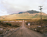 ARGENTINA, Patagonia, country road leading towards mountain against sky