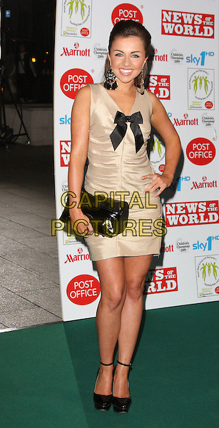 LOUISA LYTTON .Children's Champions Awards 2009 at the Grosvenor House Hotel, Park Lane, London, England, March 4th 2009..full length gold dress sleeveless black bow clutch bag ankle strap platform shoes ruched .CAP/ROS.©Steve Ross/Capital Pictures