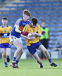 Sean O Connor of Tipperary in action against John Murphy of Clare during their Munster Minor football semi-final at Thurles. Photograph by John Kelly.