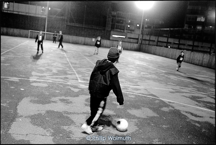 Five-a-side football game for 10-12 year olds at a Westminster Council sports centre under the Westway motorway at Westbourne Green, West London..