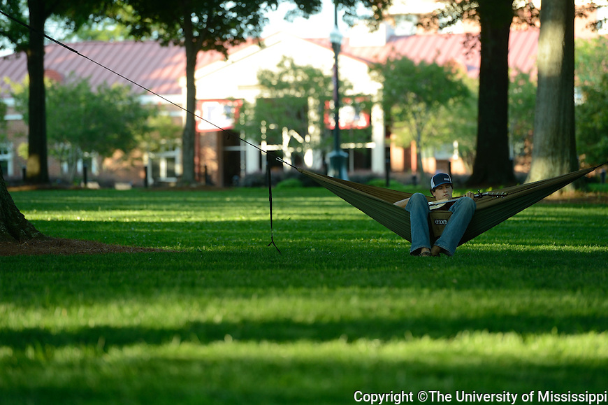 Adam Robinson, a senior biology major from Oxford, Mississippi, takes a moment, today, Thursday, May 3, 2012, to take a break between the final week of classes and exam week to play guitar in the Grove at The University of Mississippi and relax.  Photo by UM Photographer Kevin Bain