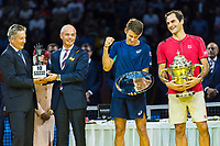 27th October 2019; St. Jakobshalle, Basel, Switzerland; ATP World Tour Tennis, Swiss Indoors Final; Alex de Minaur (AUS) celebrates his part of history after Roger Federer (SUI) wins his tenth Swiss Indoors title while Deputy Tournament Director Daniel Chambon and Tournament Managing director Patrick Ammann are ready to present a special commemorative trophy for 10 tournament wins to Roger Federer - Editorial Use