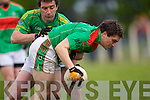 Jack Corridon of Finuge puts pressure on Barry O'Mahony of Beal in the Bernard O'Callaghan Memorial Senior Football Championship Final last Sunday in Ballylongford.