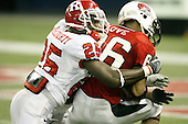 January 5th, 2008:  Rutgers corner back Jason McCourty (25) tackles Ball States Dante Love (86) during the fourth quarter of the International Bowl at the Rogers Centre in Toronto, Ontario Canada...Rutgers defeated Ball State 52-30.  ..Photo By:  Mike Janes Photography