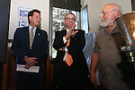 From left, Lt. Gov. Brian Krolicki, Wells Fargo Regional President Kirk V. Clausen, and Coiner Ken Hopple participate in a ceremony marking the beginning of production of the fourth and final medallion in a commemorative Sesquicentennial series at the Nevada State Museum, in Carson City, Nev., on Wednesday, Sept. 3, 2014. <br /> Photo by Cathleen Allison