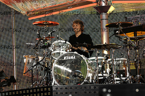 Muse - drummer Dominic Howard - performing live on the Black Holes and Revelations Tour at Wembley Stadium in London UK - 16 Jun 2007.  Photo credit: George Chin/IconicPix