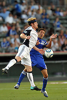 Pat Phelan (white), Davy Arnaud...Kansas City Wizards defeated New England Revolution 4-1 at Community America Ballpark, Kansas City, Kansas.