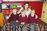 Daniel Brosnan, James Roche and Gavin Dillon with Mrs Lyons on the start of their school journey in Lyracrompane NS last Monday.