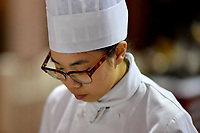 Melbourne, 30 May 2017 - Kimberly Tang commis chef assisting Daniel Soto of the Montague Hotel in South Melbourne prepares baby leeks at the Australian selection trials of the Bocuse d'Or culinary competition held during the Food Service Australia show at the Royal Exhibition Building in Melbourne, Australia. Photo Sydney Low