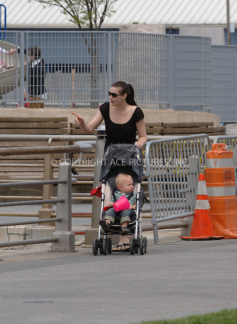 WWW.ACEPIXS.COM . . . . .  ....**EXCLUSIVE-FEE MUST BE AGREED BEFORE USE**....Actress Liv Tyler took her son Milo for a walk along the Hudson river to a park near her West Village neigborhood, stopping briefly to clean her sunglasses with the hem of her dress.....Please byline: BRETT KAFFEE-ACEPIXS.COM.... *** ***..Ace Pictures, Inc:  ..(212) 243-8787 or (646) 769 0430..e-mail: picturedesk@acepixs.com..web: http://www.acepixs.com