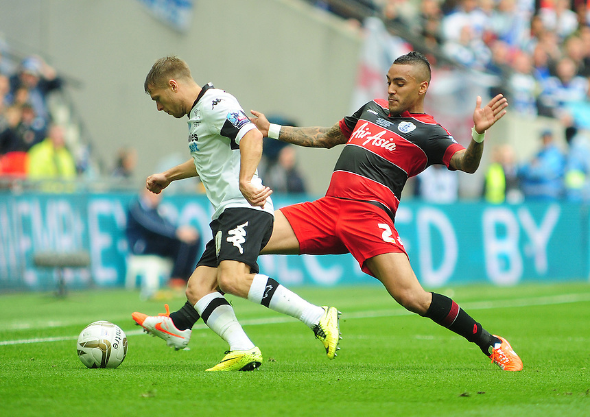 Derby County's Jamie Ward is tackled by Queens Park Rangers' Danny Simpson<br /> <br /> Photographer Chris Vaughan/CameraSport<br /> <br /> Football - The Football League Sky Bet Championship Play-Off Final - Derby County v Queens Park Rangers - Saturday 24th May 2014 - Wembley Stadium - London<br /> <br /> &copy; CameraSport - 43 Linden Ave. Countesthorpe. Leicester. England. LE8 5PG - Tel: +44 (0) 116 277 4147 - admin@camerasport.com - www.camerasport.com