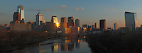 The sunsets over the Philadelphia skyline as seen from the Spring Garden Street Bridge on November 29, 2013.