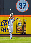 20 April 2013: New York Mets outfielder Lucas Duda pulls in a fly ball during game action against the Washington Nationals at Citi Field in Flushing, NY. The Mets fell to the visiting Nationals 7-6, tying their 3-game weekend series at one a piece. Mandatory Credit: Ed Wolfstein Photo *** RAW (NEF) Image File Available ***