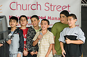 Young boys performing to a backing track at Church Street Summer Festival, London.