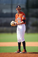 GCL Astros pitcher Forrest Whitley (63) gets ready to deliver a warmup pitch during the first game of a doubleheader against the GCL Mets on August 5, 2016 at Osceola County Stadium Complex in Kissimmee, Florida.  GCL Astros defeated the GCL Mets 4-1 in the continuation of a game started on July 21st and postponed due to inclement weather.  (Mike Janes/Four Seam Images)