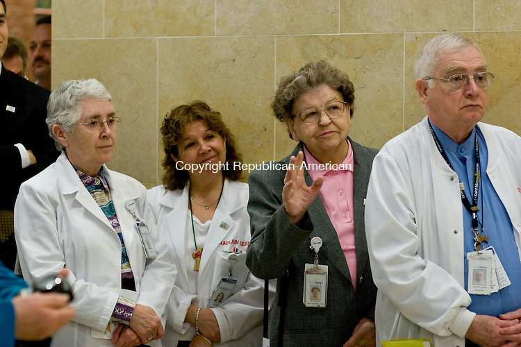 WATERBURY - (left to right) Sister Anne Corrigan, Chaplain Geralyn Cappabianca, Sister Patricia Corcoran and Deacon Paul Lauer of Saint Maryís Pastoral Care Department attend a 100th anniversary celebration for St. Mary Hospital in 2009. Corcoran is raising her hand for a blessing of the hospital.