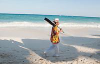 Musician walks the beach in Playa del Carmen, Quintana Roo, Mexico