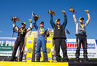 May 7, 2017; Commerce, GA, USA; (From left) NHRA top fuel driver Steve Torrence , funny car driver Ron Capps , pro stock driver Bo Butner and pro stock motorcycle rider L.E. Tonglet celebrate after winning the Southern Nationals at Atlanta Dragway. Mandatory Credit: Mark J. Rebilas-USA TODAY Sports