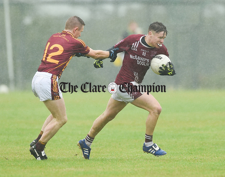 Eoin Curtin of St Joseph's Miltown Malbay in action against Aiden Davidson of St Breckan's during their first round senior championship game in Ennistymon. Photograph by John Kelly