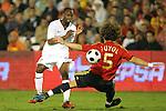 04 June 2008: Carles Puyol (ESP) (5) slides in against DaMarcus Beasley (USA) (left). The Spain Men's National Team defeated the United States Men's National Team 1-0 at Estadio Municipal El Sardinero in Santander, Spain in an international friendly soccer match.