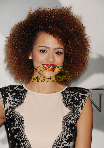 "Nathalie Emmanuel.""Game Of Thrones"" 3rd Season Los Angeles Premiere held at the TCL Chinese Theatre, Hollywood, California, USA..March 18th, 2013.headshot portrait lace black beige sleeveless red lipstick .CAP/ROT/TM.©Tony Michaels/Roth Stock/Capital Pictures"