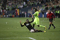 Sanna Nyassi (23)of the Seattle Sounders FC fouls Emmanuel Ekpo (17) of the  Columbus Crew . The Seattle Sounders FC defeated the Columbus Crew 2-1 during the US Open Cup Final at Qwest Field in Seattle,WA, on October 5, 2010.