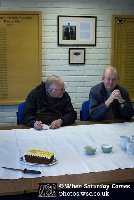Edinburgh University 3 Selkirk 2, 13/03/2016. Peffermill, Scottish Lowland League. Two 'groundhoppers' having refreshments in the clubhouse before watching Edinburgh University taking on Selkirk in a Scottish Lowland League match at Peffermill, Edinburgh in a game the hosts won 3-2. The match was one of six attended by members of GroundhopUK over the weekend to accommodate groundhoppers, fans who attempt to visit as many football venues as possible. Around 100 fans in two coaches from England participated in the 2016 Lowland League Groundhop and they were joined by other individuals from across the UK which helped boost crowds at the six featured matches. Photo by Colin McPherson.