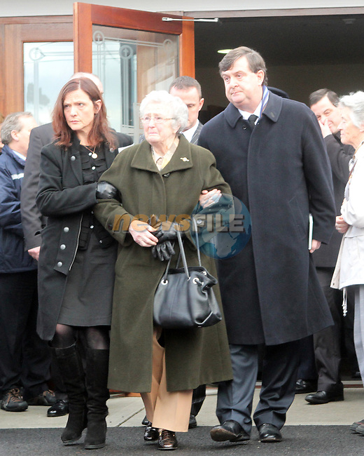 Shane McEntee's Mother is led out of the church at the Funeral of Minister of State Shane McEntee which took place today in Nobber, Co.Meath...Photo NEWSFILE/Jenny Matthews..(Photo credit should read Jenny Matthews/NEWSFILE)