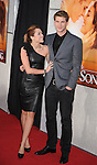 """HOLLYWOOD, CA. - March 25: Miley Cyrus and Liam Hemsworth arrive to """"The Last Song"""" Los Angeles Premiere at ArcLight Hollywood on March 25, 2010 in Hollywood, California."""