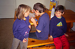 AREMN2 Three children at kitchen table at breakfast time