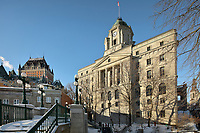 Louis S St-Laurent Building, built 1872-73 in Second Empire style, and reworked 1913-19 in Beaux Arts style, the Old Post Office, in Quebec City, Quebec, Canada. On the left is the Chateau Frontenac, opened 1893, designed by Bruce Price as a chateau style hotel for the Canadian Pacific Railway company or CPR. The building was extended and the central tower added in 1924, by William Sutherland Maxwell. It is now a hotel, the Fairmont Le Chateau Frontenac, and is listed as a National Historic Site of Canada. The Historic District of Old Quebec is listed as a UNESCO World Heritage Site. Picture by Manuel Cohen