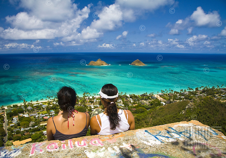 Young local Japanese women enjoying the view from the Pillbox on Kaiwa Ridge Trail above Lanikai