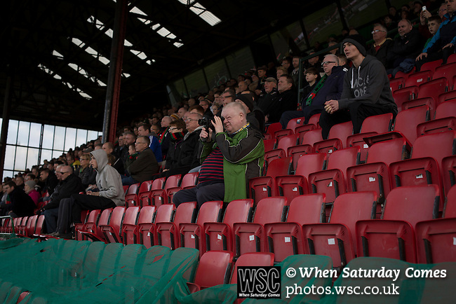 Glentoran 2 Cliftonville 1, 22/10/2016. The Oval, NIFL Premiership. Home supporters in the main stand watching the second-half action at The Oval, Belfast as Glentoran host city-rivals Cliftonville in an NIFL Premiership match. Glentoran, formed in 1892, have been based at The Oval since their formation and are historically one of Northern Ireland's 'big two' football clubs. They had an unprecendentally bad start to the 2016-17 league campaign, but came from behind to win this fixture 2-1, watched by a crowd of 1872. Photo by Colin McPherson.