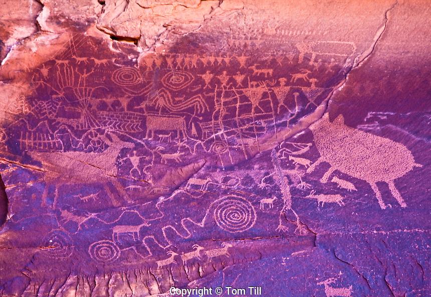 Petroglyphs on high rock wall, Utah