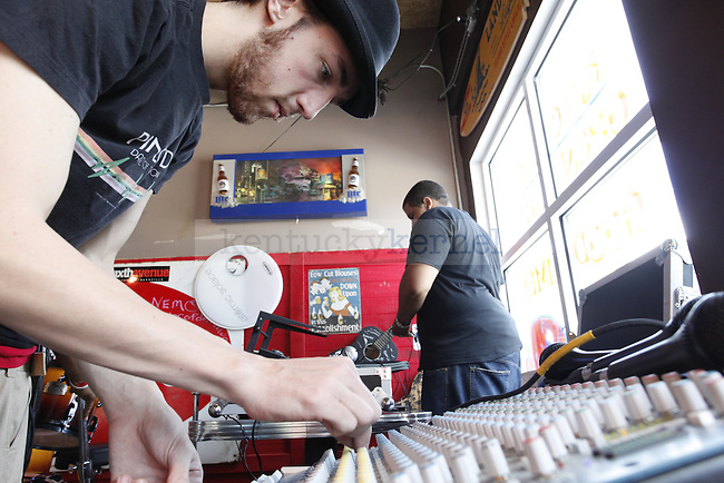 Eric Myers sets up the levels on a sound board for the Kuntry Noiz on August 30 at Tin Roof on South Limestone...PHOTO BY ZACH BRAKE I STAFF