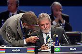 President Luiz Inacio Lula da Silva of Brazil, right, speaks to Celso Amorim, minister of foreign relations of Brazil, during the opening plenary during the Nuclear Security Summit at the Washington Convention Center in Washington, D.C., U.S., on Tuesday, April 13, 2010. Ukraine's agreement to relinquish its entire stockpile of highly enriched uranium gave Obama the first concrete result for a summit he convened on securing the world's atomic material..Credit: Andrew Harrer / Pool via CNP